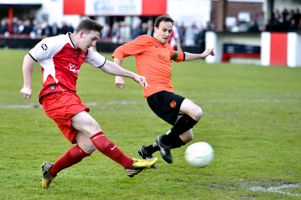 Sam Whiting in red this time for Bracknell Town against Wokingham. Sam is back at the Satsuma's and should be in orange again this evening. Photo: Connor Sharod-Southam.