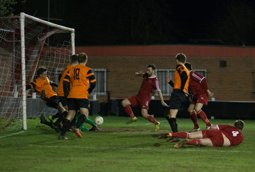 Adam Cornell in front of goal for Bracknell Town against Wokingham & Emmbrook. Photo: Richard Claypole.