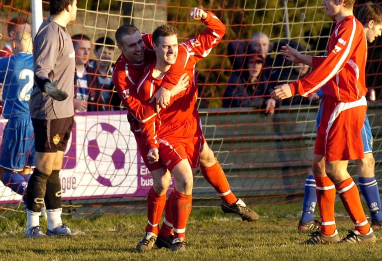 Mark Anderson scoring for Bracknell Town - mobbed by Graham Lewis. Photo: getreading.co.uk
