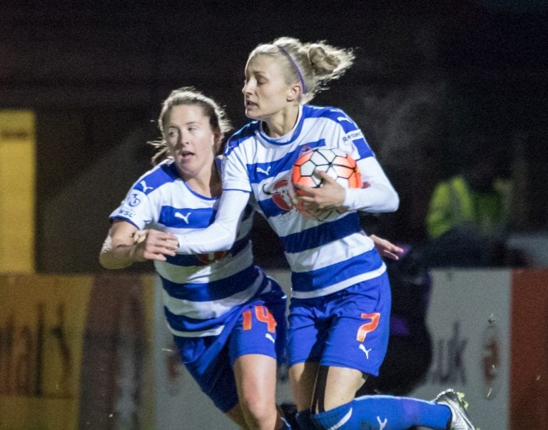 Emma Follis grabs the ball after scoring for Reading Women. Photo: Neil Graham.
