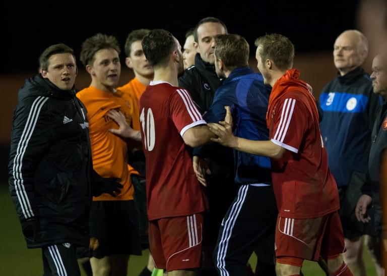 A bit of a coming together at full-time of Bracknell Town versus Wokingham & Emmbrook. Photo: Richard Claypole.