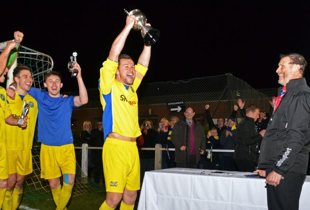 Ascot United captain Dave Hancock lifts the Floodlit Cup. Photo: Mark Pugh.