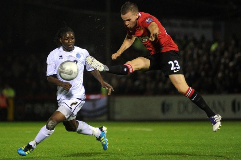Jermaine McGlashan against Manchester United's Tom Cleverley in the Football League Cup. Photo: Aldershot News & Mail.