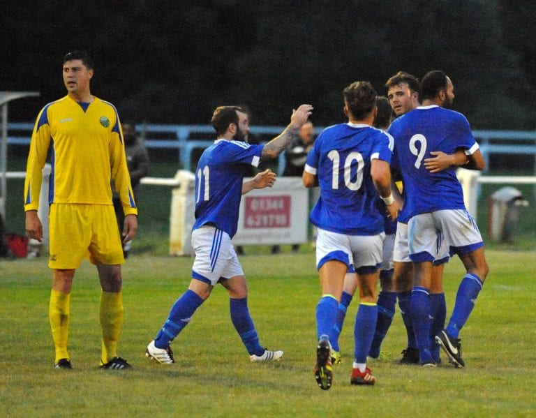 Anthony White celebrates scoring for Highmoor-IBIS. Photo: Mark Pugh.