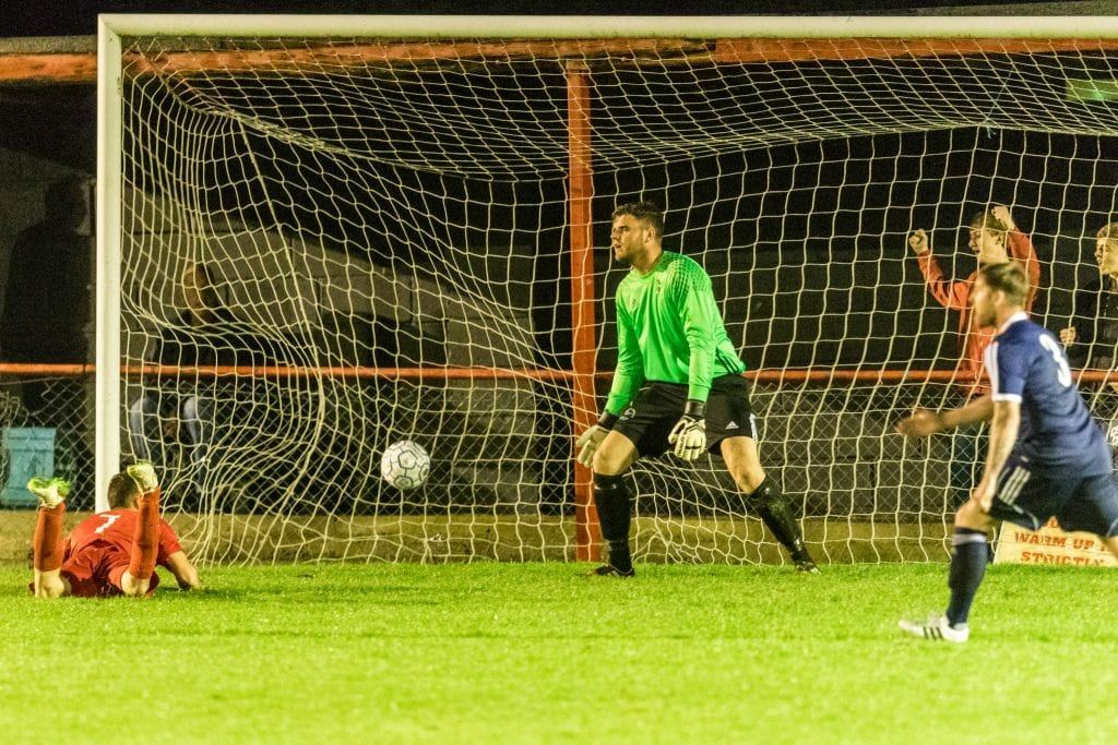 Bracknell Town's Chris Grace is beaten at Flackwell Heath. Photo: Neil Graham.