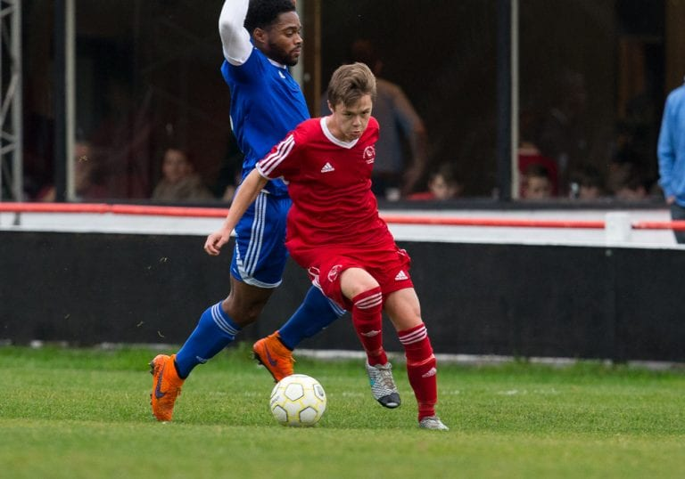 Bracknell Town's George Lock against Highmoor-IBIS. Photo: Richard Claypole.