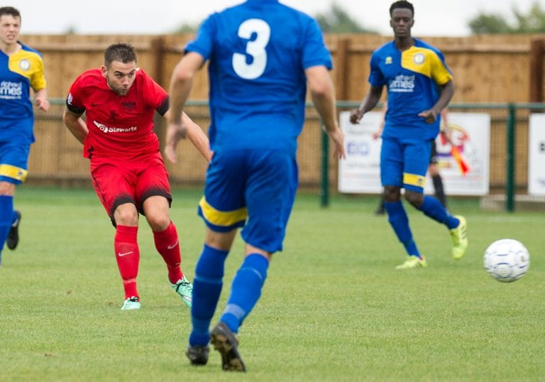 Jamie Connor strikes for Binfield FC. Photo: Colin Byers.
