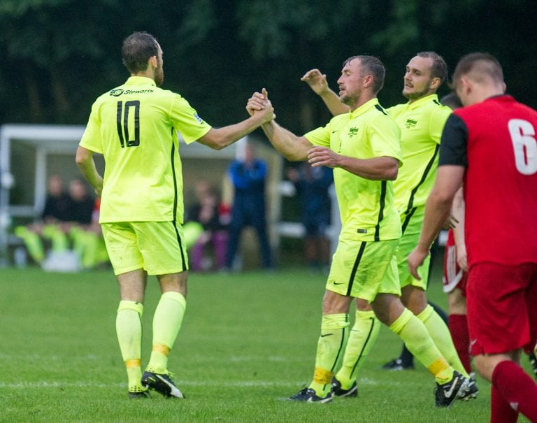 Liam Ferdinand (10) is congratulated by his Binfield team mates. Photo: Colin Byers.