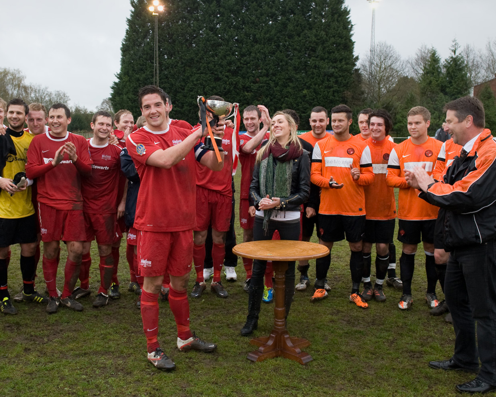 Garry Callaway lifts the Martin Joyce Memorial Trophy for Binfield in 2012 after beating Wokingham & Emmbrook at Larges Lane. Photo: Colin Byers.