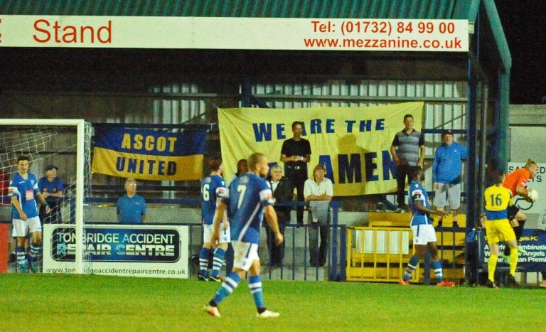 Ascot United's travelling support sing well to be heard over a majority home based crowd of 376 Photo: Mark Pugh.