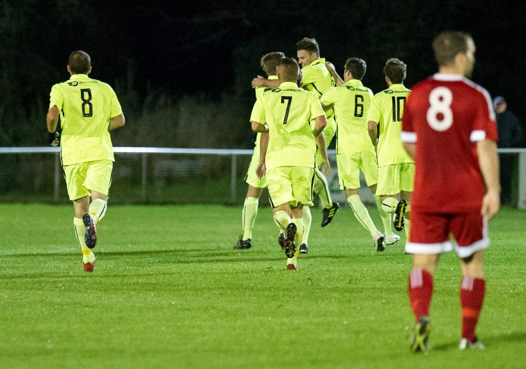Binfield players celebrate Jack Broome's goal against Bracknell Town in the FA Vase. Photo: Colin Byers.