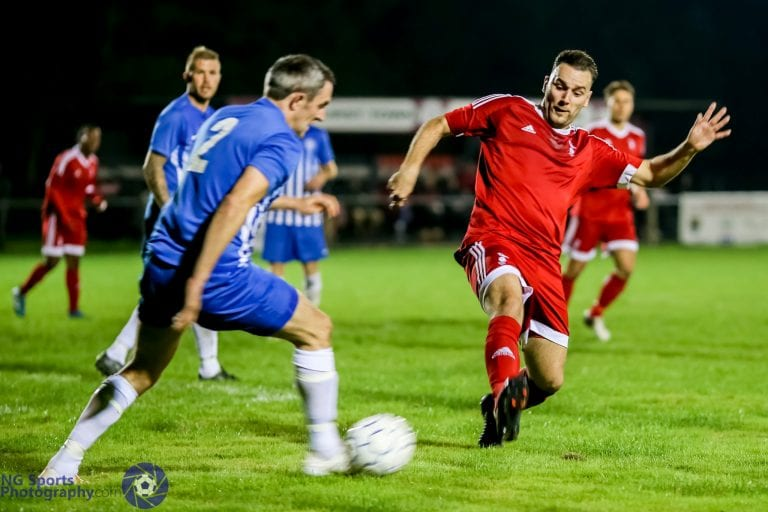 Adam Cornell closes down for Bracknell Town FC against Thatcham Town FC. Photo: Neil Graham.