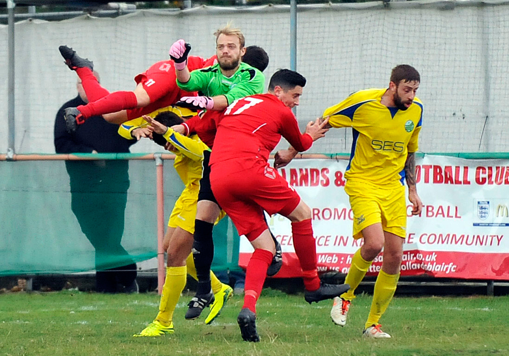 Carl Dennison in the thick of it for Ascot United FC. Photo: Mark Pugh.