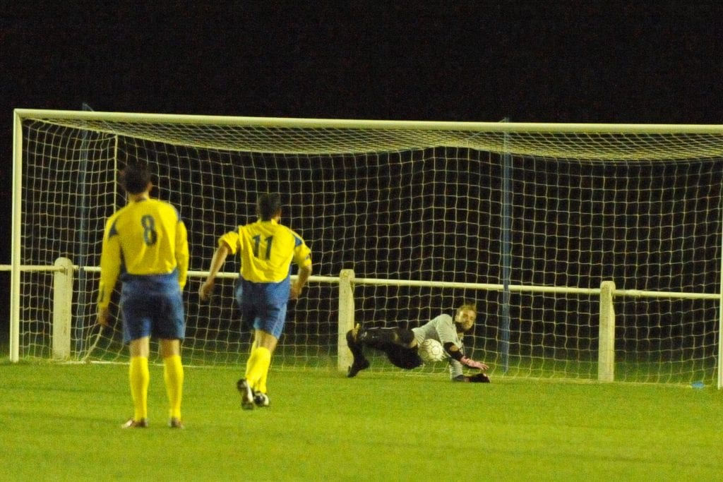 Carl Dennison deniesa Highmoor spot kick for Ascot United FC. Photo: Mark Pugh.