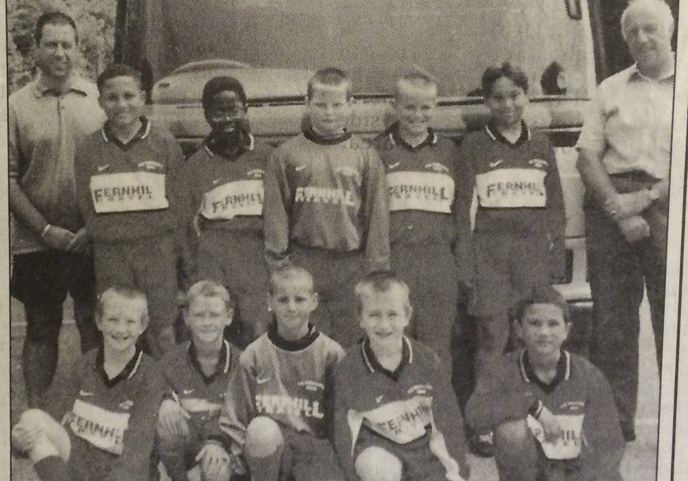 Can you spot the current Wokingham & Emmbrook midfielder in this 2000 image?