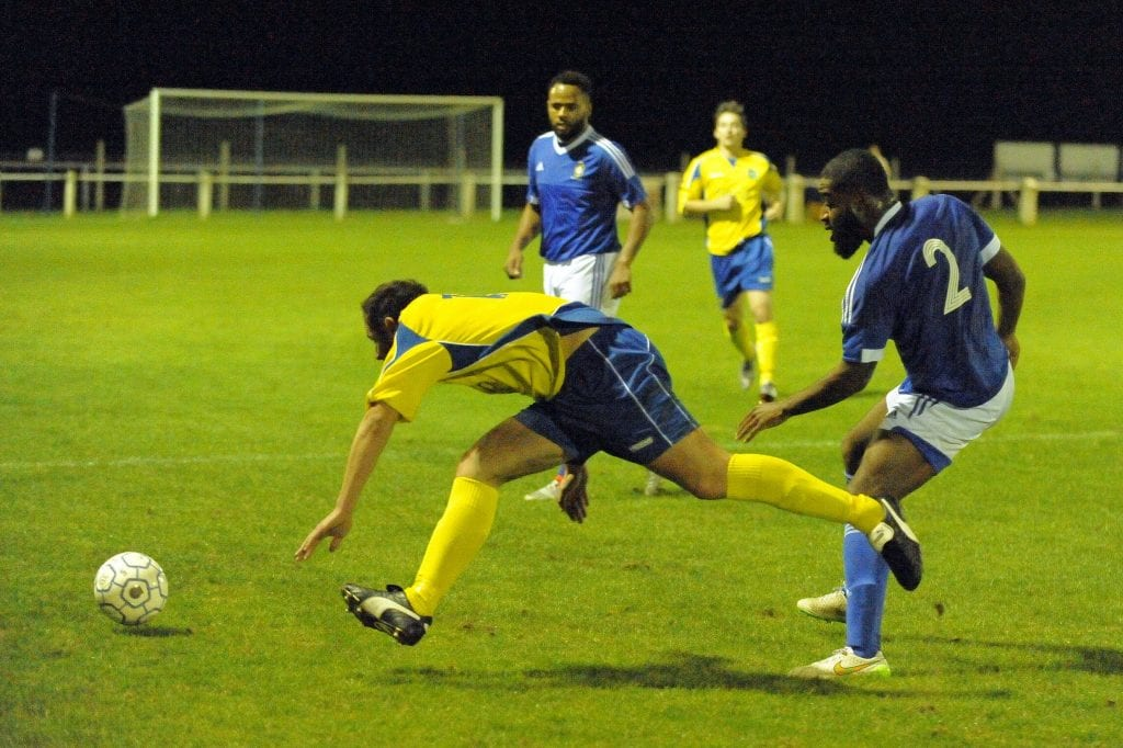 Frankie Boaman takes on Ascot United FC's Jeff Lamb. Photo: Mark Pugh.