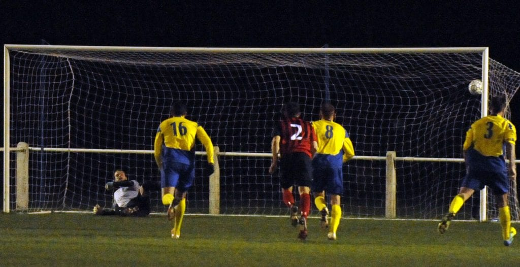 Dave Merrick scores from the penalty spot for Longlevens against Ascot United FC. Photo: Mark Pugh.