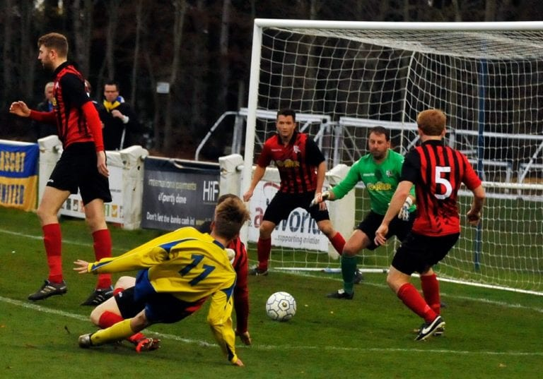 James Goodey gets a shot away for Ascot United FC. Photo: Mark Pugh.