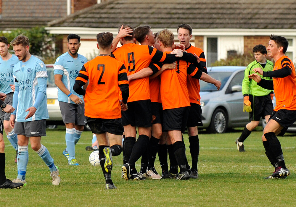 Wokingham & Emmbrook celebrate against Woodley United. Photo: Mark Pugh.