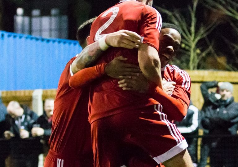 Kensley Maloney is mobbed by his Bracknell Town FC team mates. Photo: Richard Claypole.