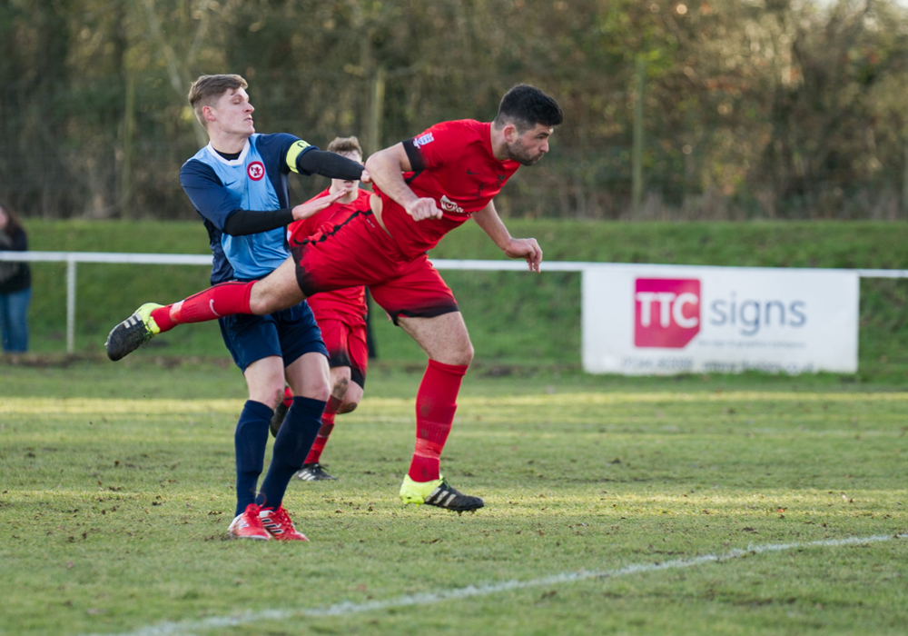 Jon Bennett scores for Binfield against Sandhurst Town. Photo: Colin Byers.