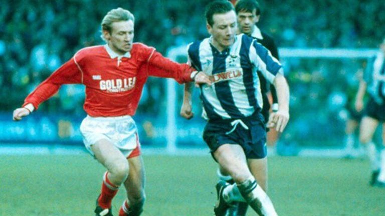 Mark Franks playing for Woking against West Bromwich Albion. Photo via @cardinal_tales