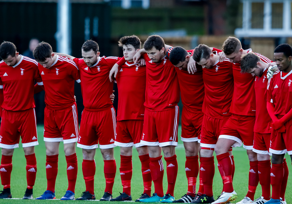 Bracknell Town FC hold a minutes silence for former chairman Dave Mihell. Photo: Neil Graham.