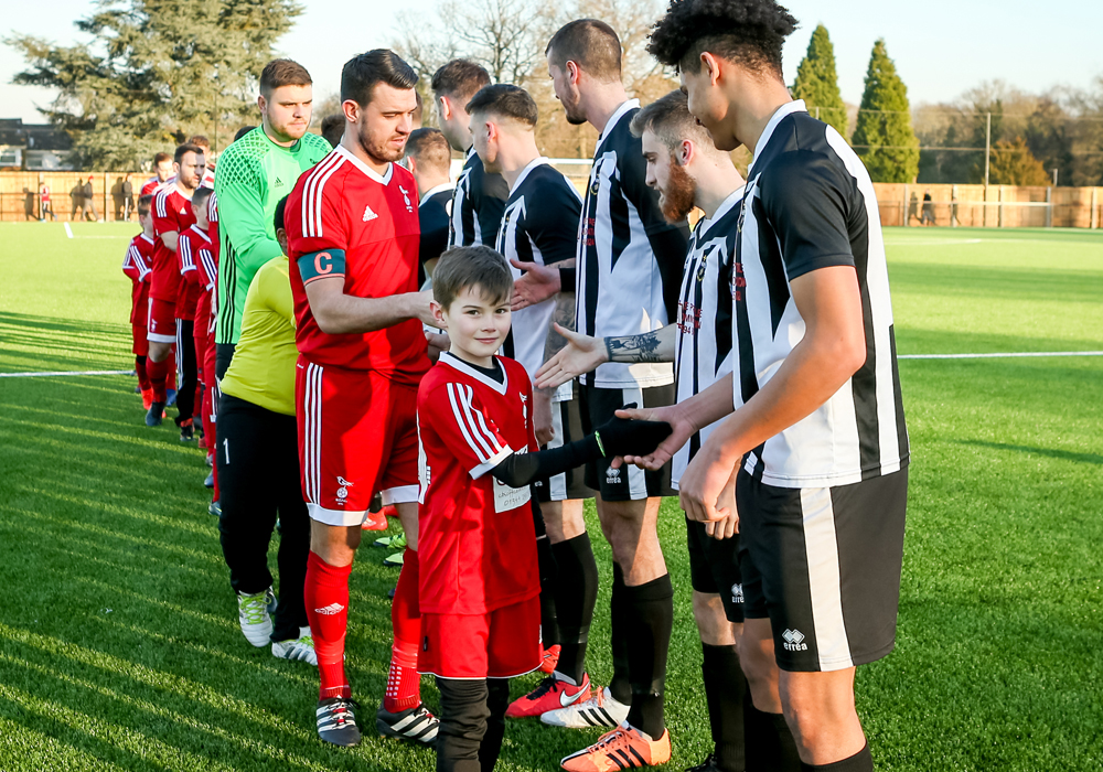 Teams shake hands before Bracknell Town FC vs Lydney Town AFC. Photo: Neil Graham.