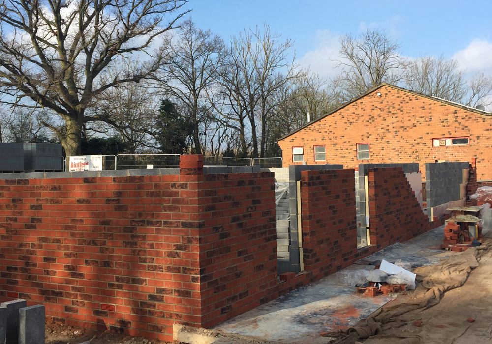Walls going up at Hill Farm Lane around the new changing room block. Photo: Bob Bacon.