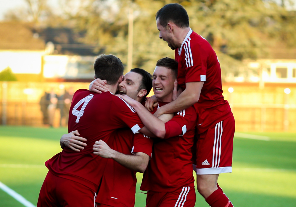 George Short is mobbed after scoring for Bracknell Town. Photo: Neil Graham.