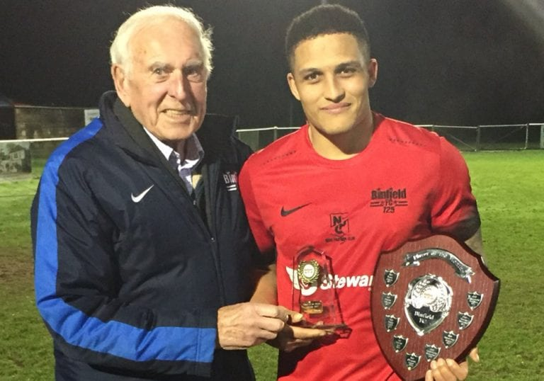 Alec Lloyd presents the player of the month award to Harrison Bayley. Photo: @binfieldfc
