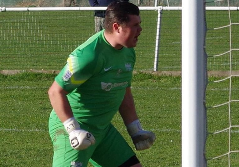 Liam Vaughan roars after saving a penalty for Binfield FC. Photo: James Green.
