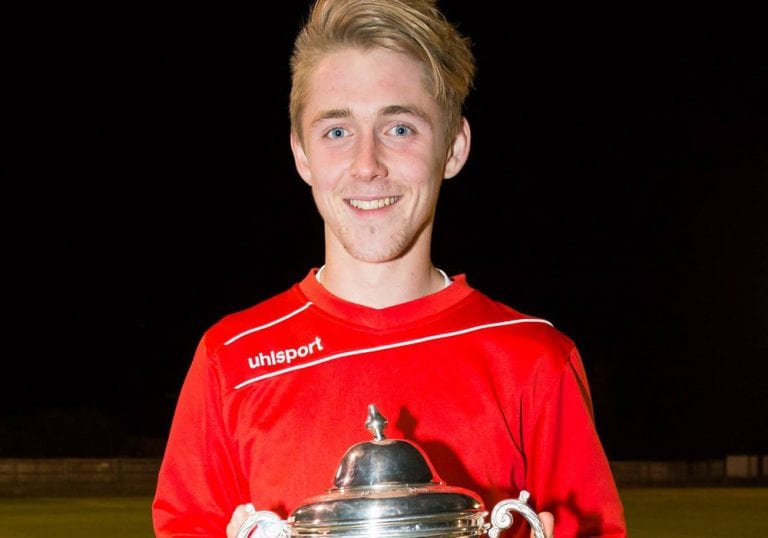 Dan Roberts with the County Cup. Photo: Neil Graham.