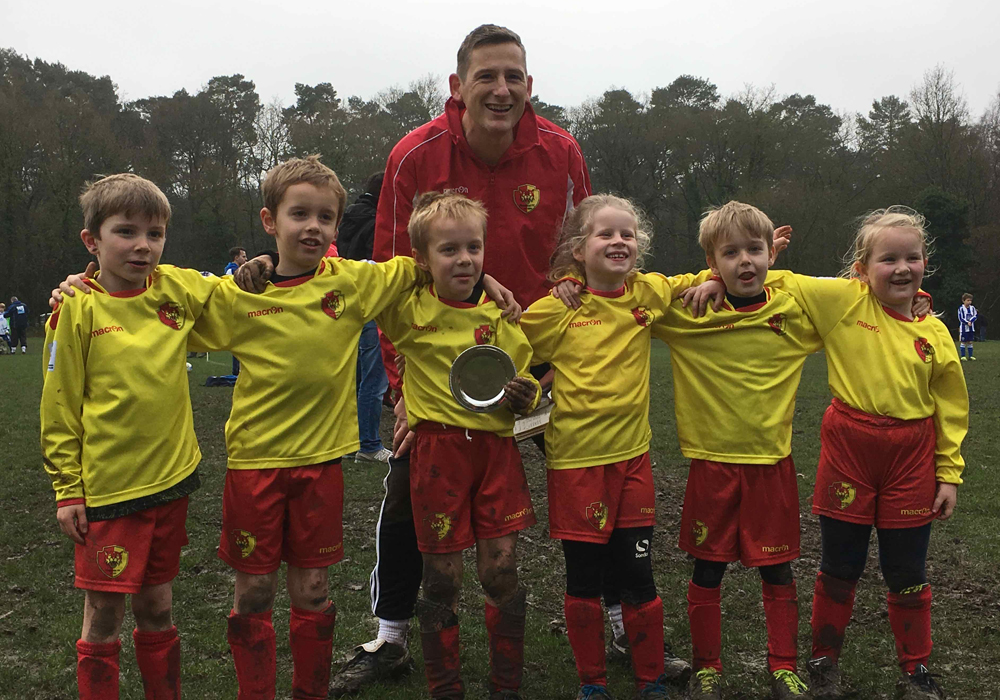Dean Allen and a Pinewood FC team. Image supplied by Pinewood FC.