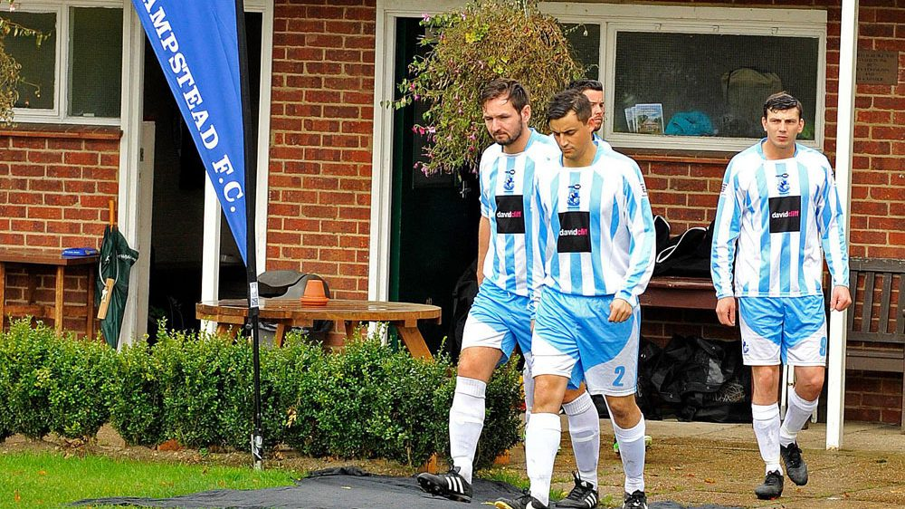 Players emerge from the changing rooms at Finchampstead FC. Photo: Mark Pugh.