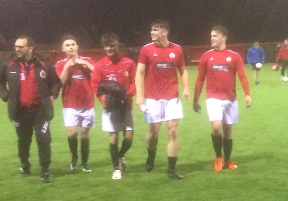 Victorious Sandhurst Town FC leave the pitch. Photo: @sandhursttownfc