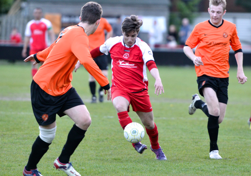 Action from Wokingham Emmbrook vs Bracknell Town in the 2013/14 Reading Senior Cup semi final. Photo: Connor Sharod-Southam.
