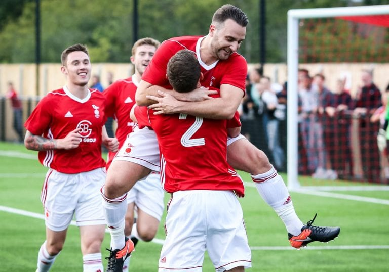 Adam Cornell celebrates scoring for Bracknell Town. Photo: Neil Graham.