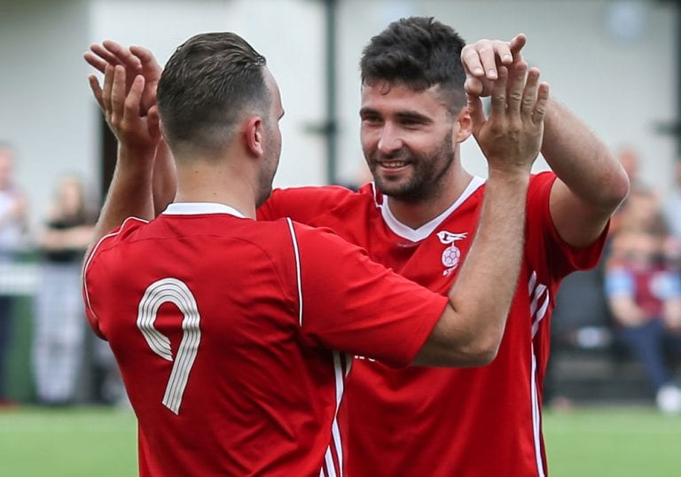 Jon Bennett celebrates scoring for Bracknell Town. Photo: Neil Graham.