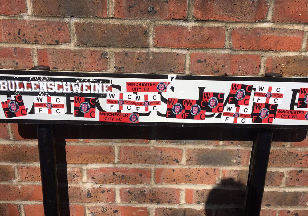 The Larges Lane road sign stickered by Winchester City fans. Photo: bracknelltownfc
