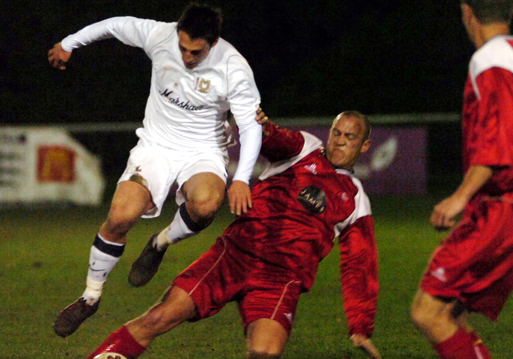 Bracknell Town's Chris Geary challenges an MK Dons player in the County Cup. Photo: Get Reading.