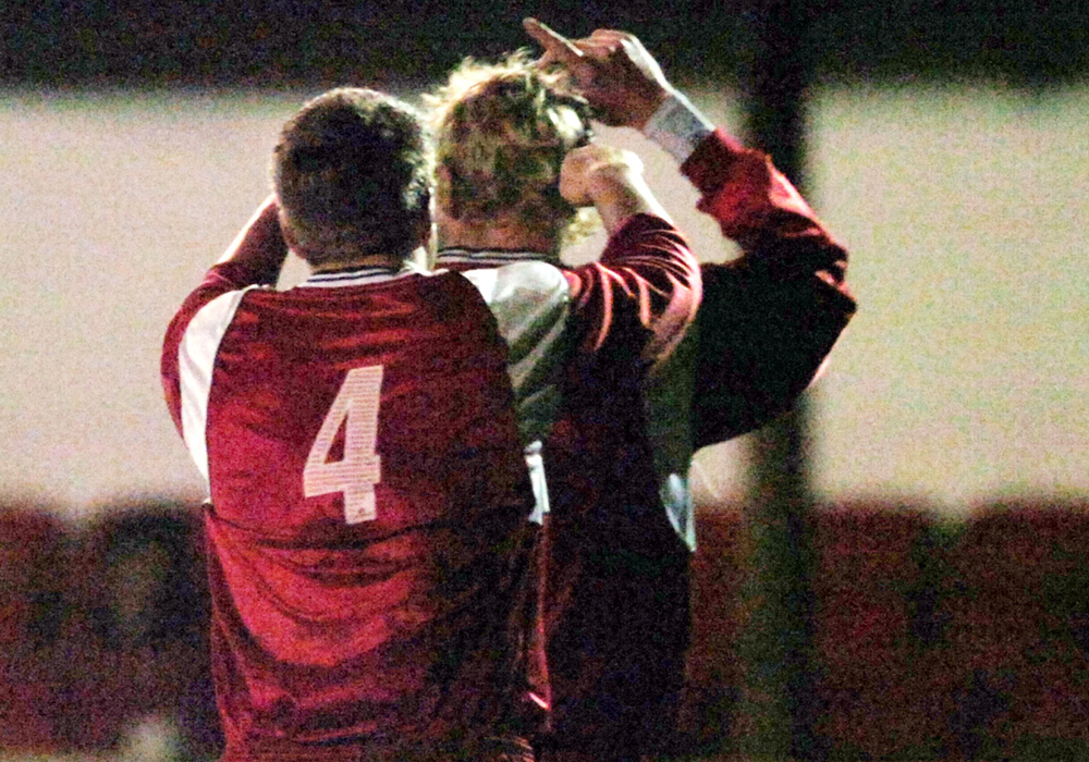 Michael Buck points to the sky after scoring the only goal for Bracknell Town against MK Dons in the County Cup. Photo: Get Reading.