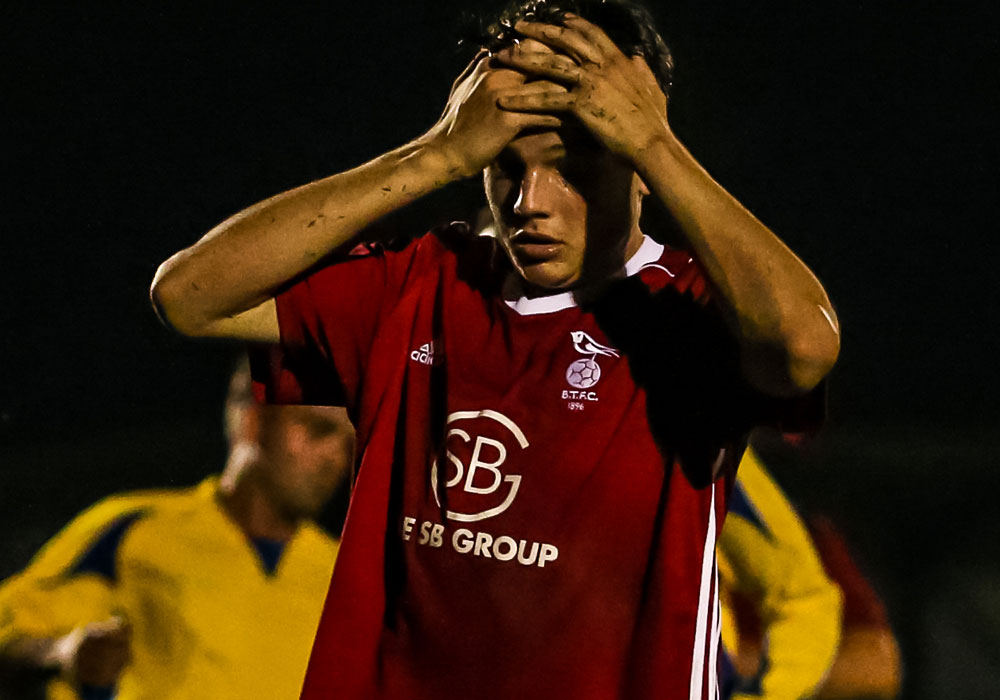 A head in hands moment for Bracknell Town's Seb Bowerman at Ascot United. Photo: Neil Graham.