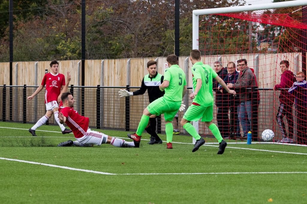 Adam Cornell scores for Bracknell Town against Oxford City Nomads. Photo: Richard Claypole.