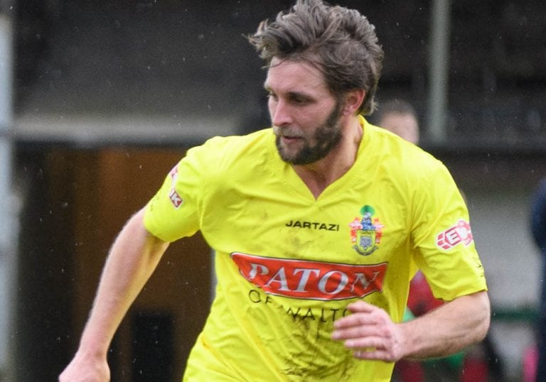 Ryan Parsons in action for Egham Town. Photo: Get Surrey.