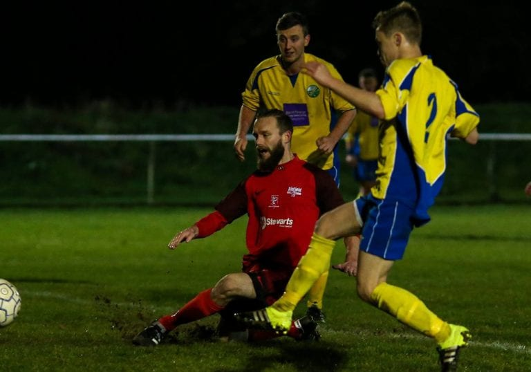 Ian Davies shoots for Binfield against Ascot United in the Second Round of the Floodlit Cup. Photo: Neil Graham.