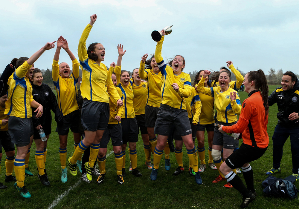 Woodley United Ladies celebrate a league title. Photo: Neil Graham.