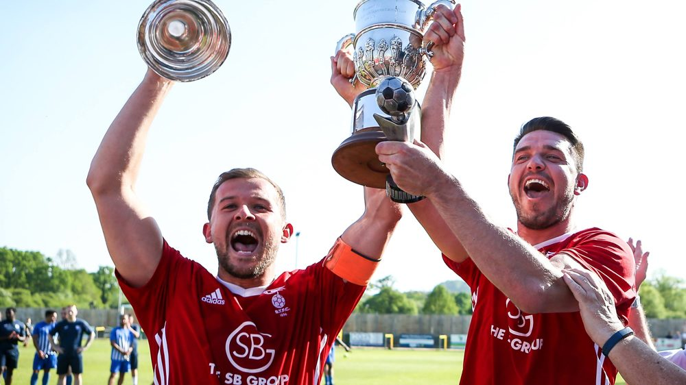 Bracknell Town captain Dave Hancock and manager Carl Davies lift the Hellenic League Challenge Cup. Photo: Neil Graham.