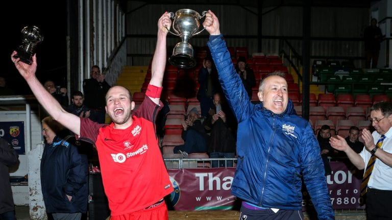 Binfield captain James Knight and manager Roger Herridge lift the Floodlit Cup. Photo: Neil Graham.