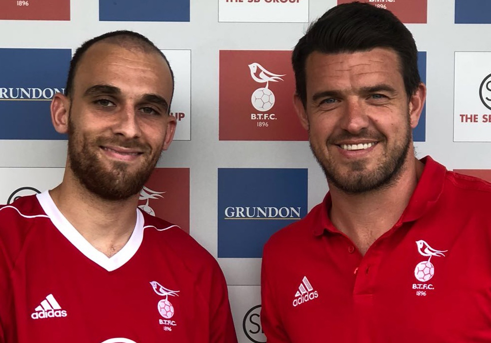 Liam Ferdinand (left with Carl Davies) re-signs for Bracknell Town. Photo: Bracknell Town FC